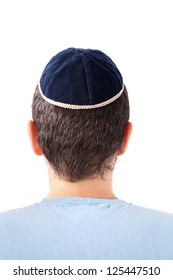 Rear view of a man wearing a Kippah on white background