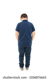 Rear view of modern little boy, standing with hands in pockets. Isolated on white background
