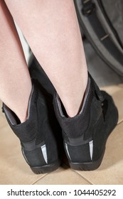 Rear view at the motorcycle safety street shoes with women legs, close up