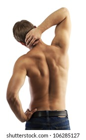 Rear view of a muscular young man in jeans with bare torso