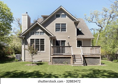 Rear view of new construction home with deck