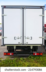 Rear view of new white cargo truck