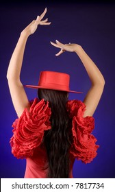 Rear view on a young Spanish flamenco dancer in a red dress