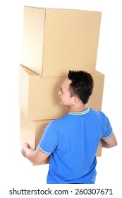 rear view portrait of young man carrying stack of cardboxes
