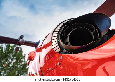 Rear view of an red helicopter with exhaust