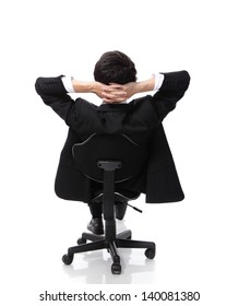 Rear view of a relaxed businessman with hands behind his head and sit on a chair