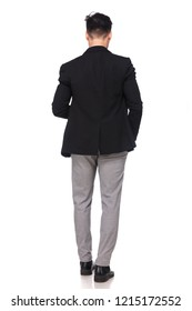 rear view of relaxed businessman standing with hand in pocket on white background