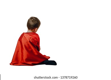 Rear view of a sad and lonely child. The concept of loneliness, isolation of children from parents. Problem with children's depression. Psychological help for young people.