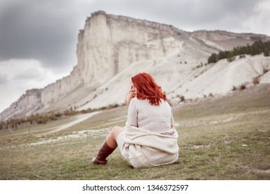 rear view of sad lonly woman looking to the mountain
