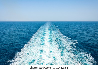 Rear view from ship to sea. Waves and foam, blue sea water and rear view to ocean from cruise ship.