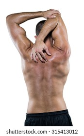 Rear view of shirtless athlete stretching elbow against white background