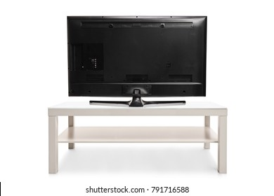 Rear view shot of a television isolated on white background