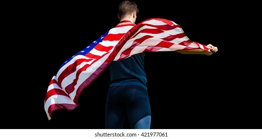 Rear view of sportsman holding an american flag