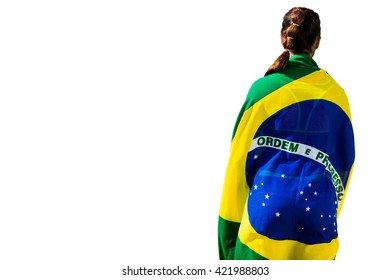 Rear view of sporty woman holding the Brazilian flag