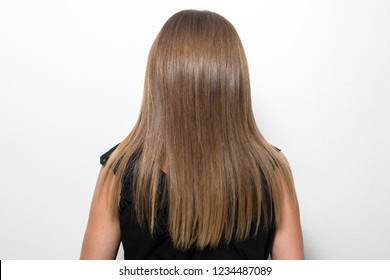 Rear view of straight hair. Soft focus