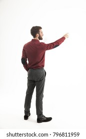 rear view - a successful Manager of a pointing hand on the blank