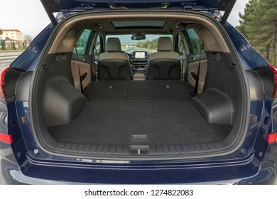 Rear view of a SUV car with open trunk
