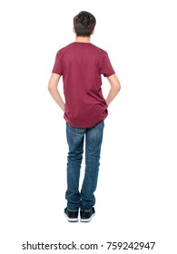 Rear view, teen boy standing at studio over white background