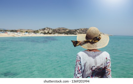 Rear view of tourist woman at the beach
