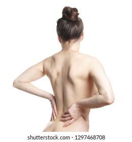 rear view of unrecognizable naked young woman suffering from lower back pain or backache isolated on white