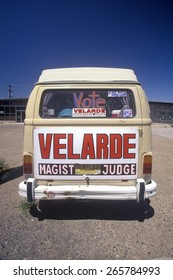 Rear view of a van with large campaign sign that reads Velarde - Magistrate Judge, NM