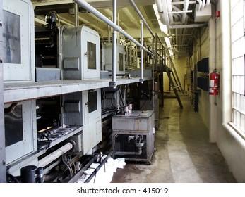 Rear view of web press (printing press) at publishing company