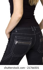 Rear view of woman in black denim jeans and black top on white background