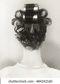 Rear view of woman with curlers in her hair