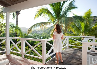 Rear view of woman enjoying the view from a balcony