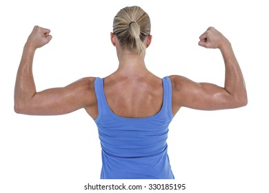Rear view of woman flexing muscles against white background