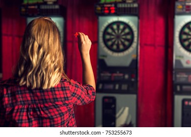 Rear view of a woman playing darts