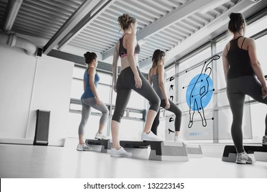 Rear view of women doing exercise with blue futuristic interface showing how to do