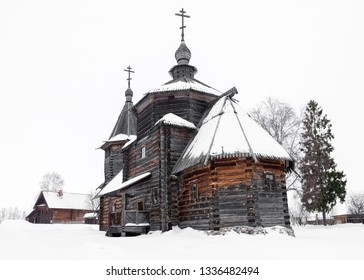 Rear view of a wooden church in the snow