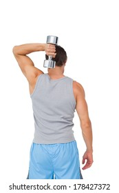 Rear view of a young man exercising with dumbbell over white background