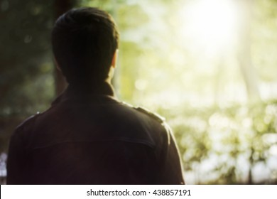 Rear view of a young man over nature background