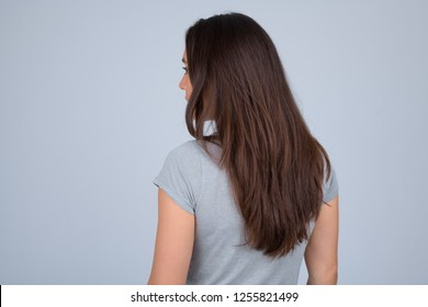 Rear view of young multi-ethnic woman against white background