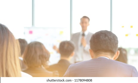 Rear View of  Young Office Employees in a Business Meeting Inside the Office, Listening to Someone Presenting Something,business seminar in conference centre,  Young business poeple learning.