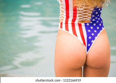 Rear view of a young patriotic woman with a perfect deriere