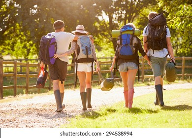 Rear View Of Young People Going Camping At Music Festival