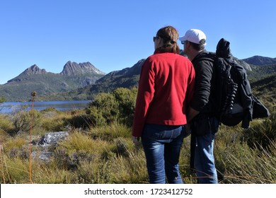 rear view of a young tourist couple looking at the landscape view of  Cradle Mountain-Lake St Clair National Park Tasmania, Australia.
