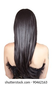 Rear view of young woman with black silky hair, isolated on white background