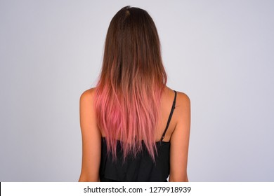 Rear view of young woman with hair dyed