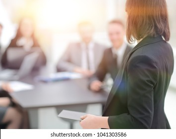 rear view.business woman on blurred background