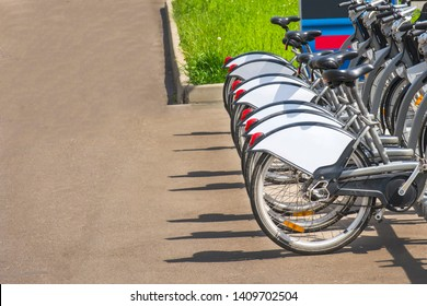 Rear wheel bike, standing in a row in the city parking for bicycles