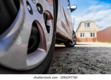 Rear wheel of car parked in country close
