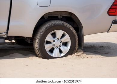 Rear wheels of a truck stuck in sand
