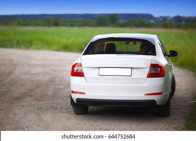 Rear-side view of a car on nature background