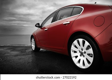 Rear-side view of a luxury cherry red car with monochrome background