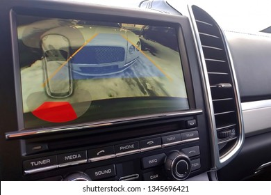Rearview camera with dynamic trajectory turning lines and parking assistant. Driver assistance systems for parking. View of the monitor.