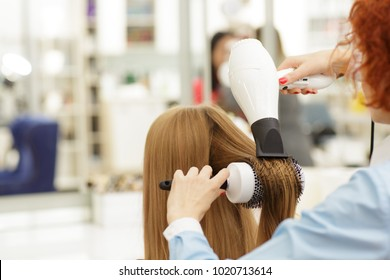 Rearview cropped close up of a professiona stylish drying hair of her female client with a blow dryer copyspace work worker staff job service occupation profession job peopleskillful expert.